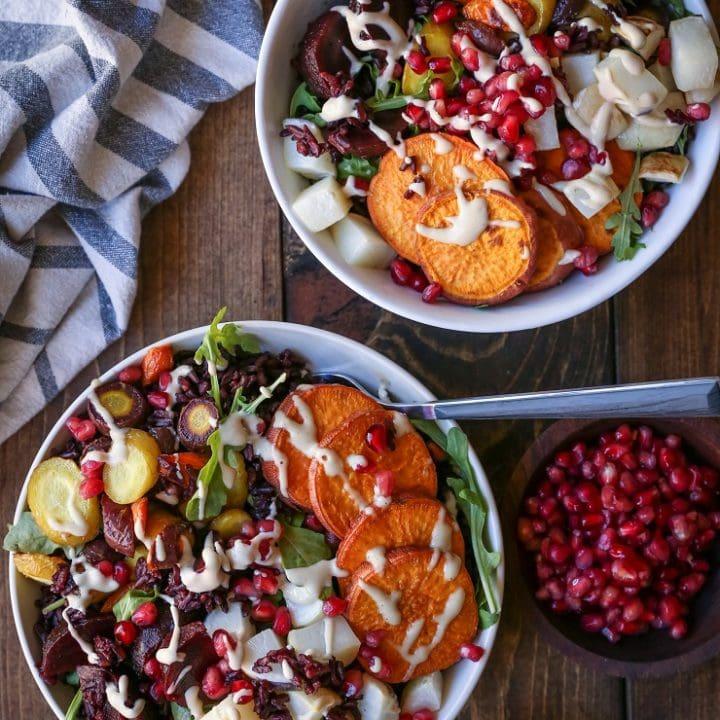Roasted Winter Vegetable Rice Bowls with Nutmeg Tahini Dressing - a nutritious vegan meal | TheRoastedRoot.net #vegetarian #glutenfree #vegan #almostpaleo #lovebeets