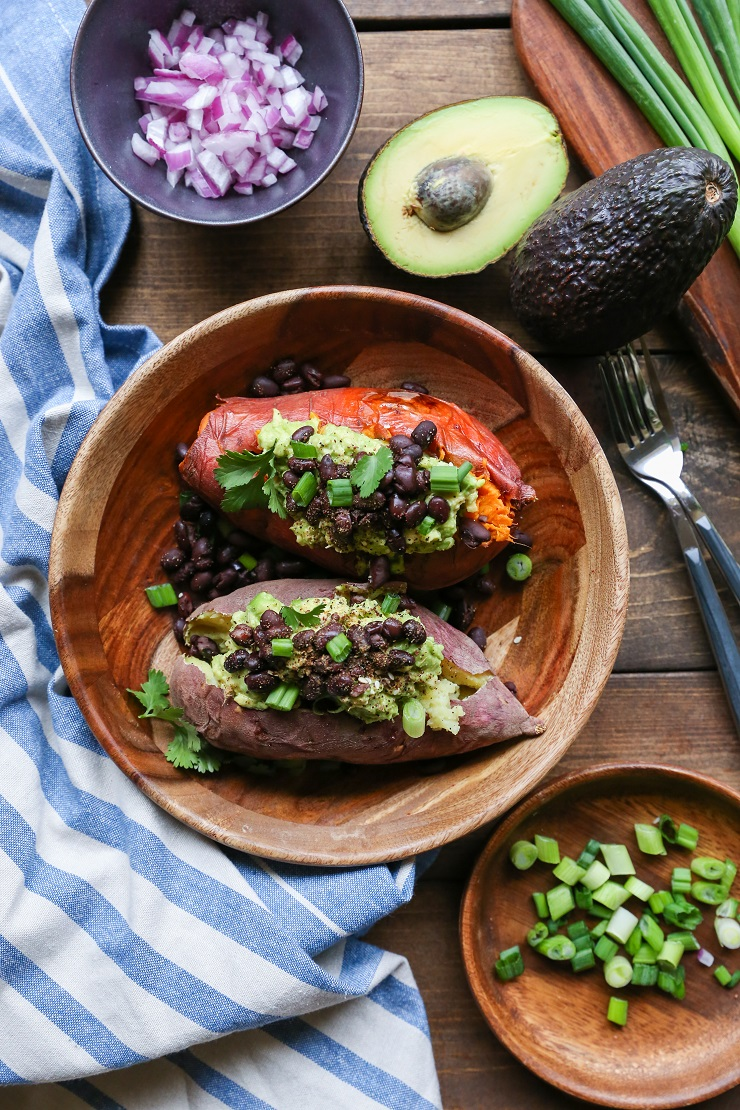 Guacamole and Black Bean Loaded Sweet Potatoes | TheRoastedRoot.net #healthy #glutenfree #recipe #vegan #vegetarian