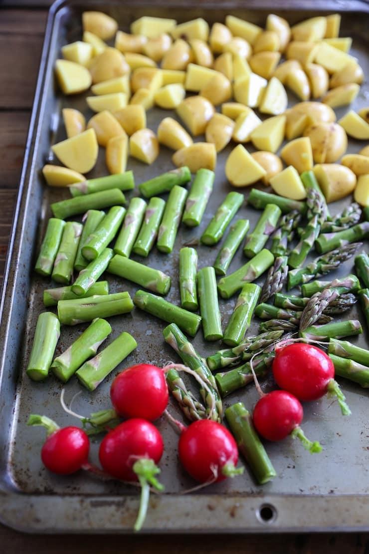 Roasted Spring Vegetable Buddha Bowls with Avocado Green Goddess Dressing   TheRoastedRoot.net #healthy #dinner #recipe #vegan #vegetarian