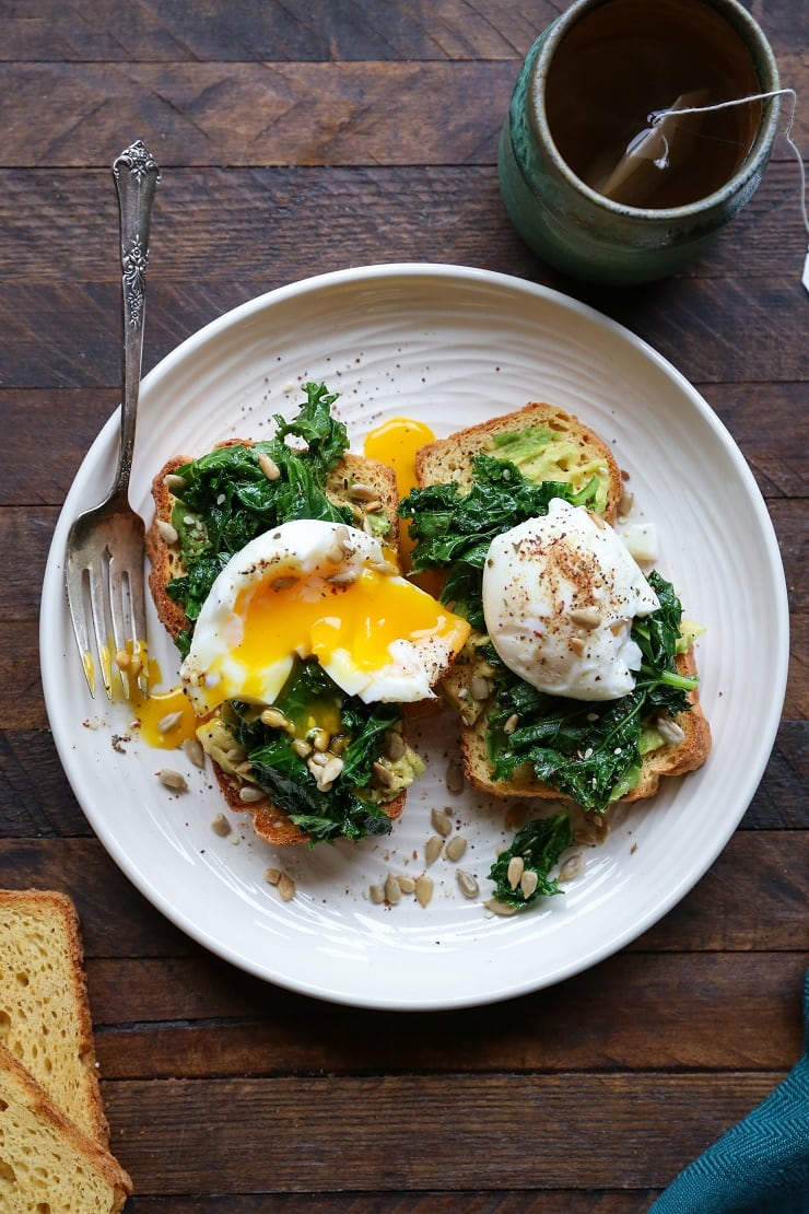 Avocado toast with kale and egg on top of homemade gluten-free sandwich bread