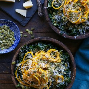 Spiralized Golden Beet and Kale Salad recipe with pumpkin seeds, hemp seeds, and parmesan cheese. A healthy vegetarian side dish!