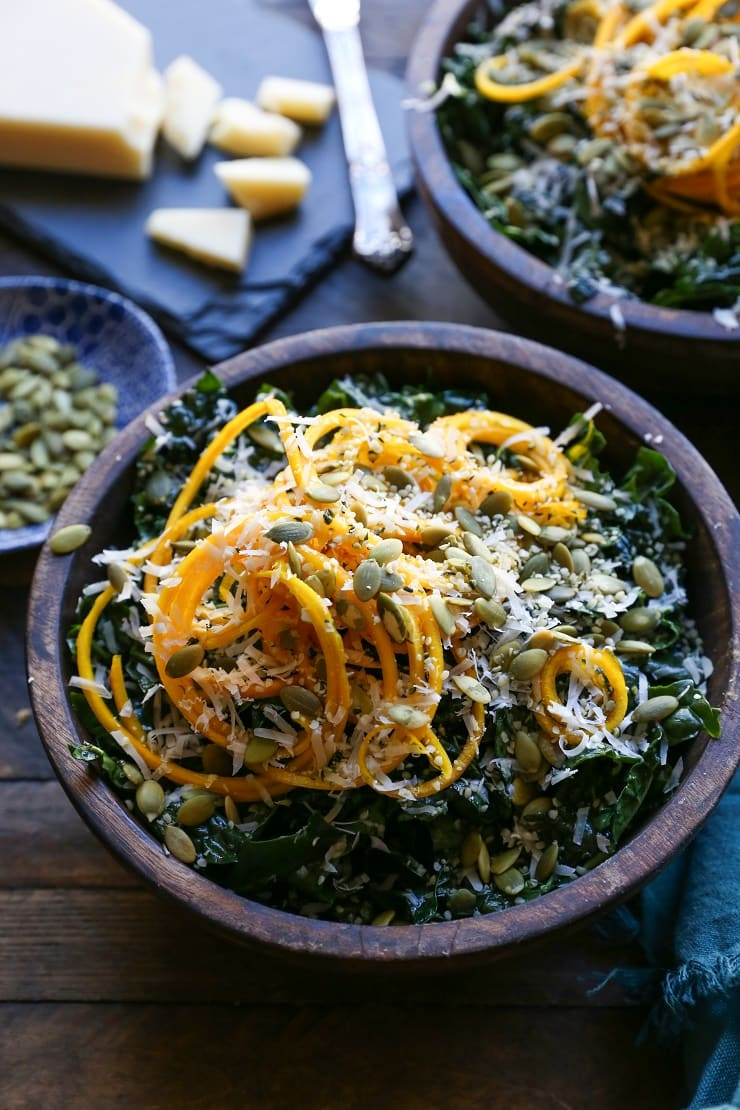 Spiralized Golden Beet and Kale Salad with parmesan, pumpkin seeds, and hemp seeds. A healthy vegetarian side dish or entree.