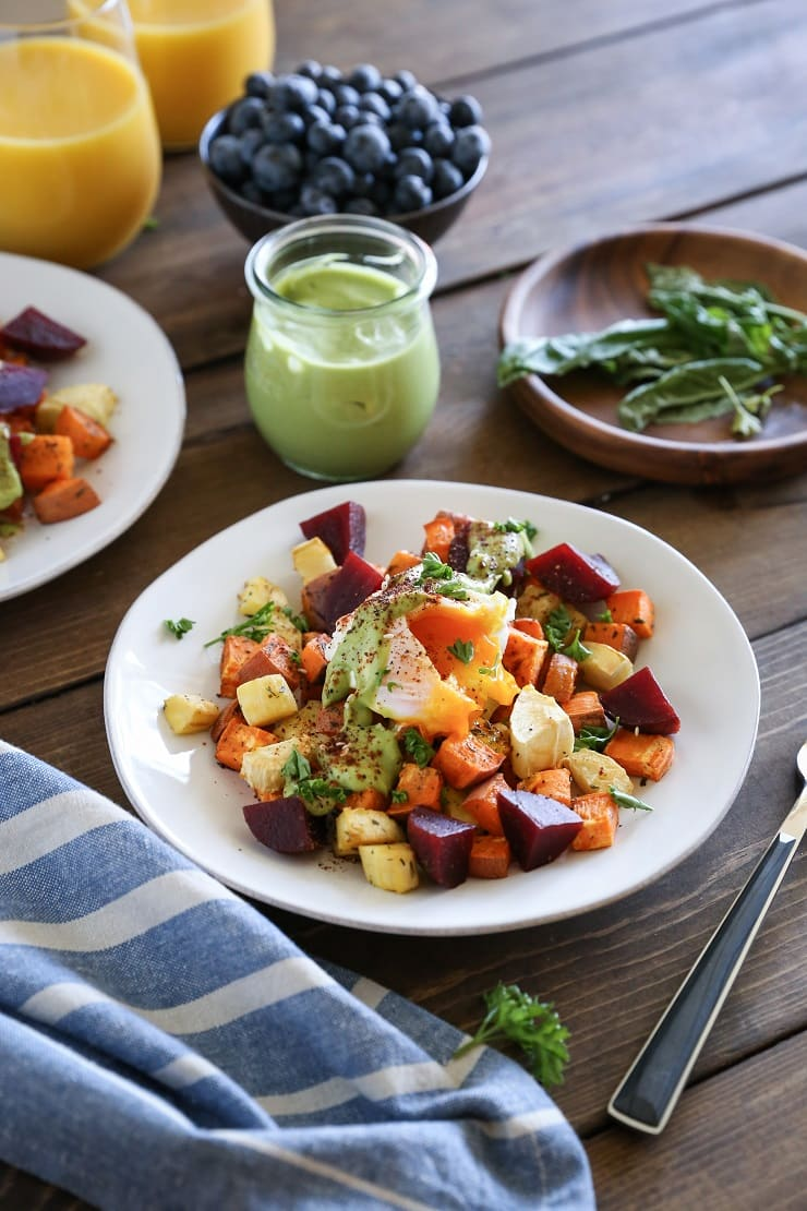 Paleo Eggs Benedict with Avocado Hollandaise with roasted root vegetables - a cleaner assume on the classic brunch recipe