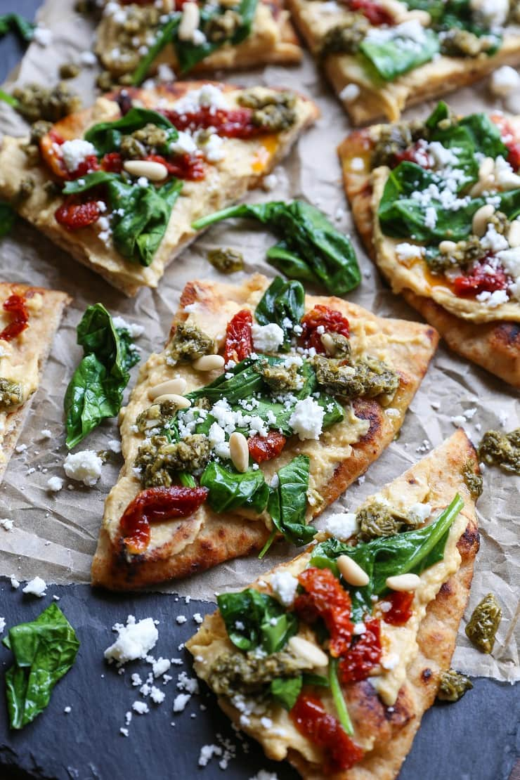 hummus flatbread with sun-dried tomatoes & pesto - the roasted root