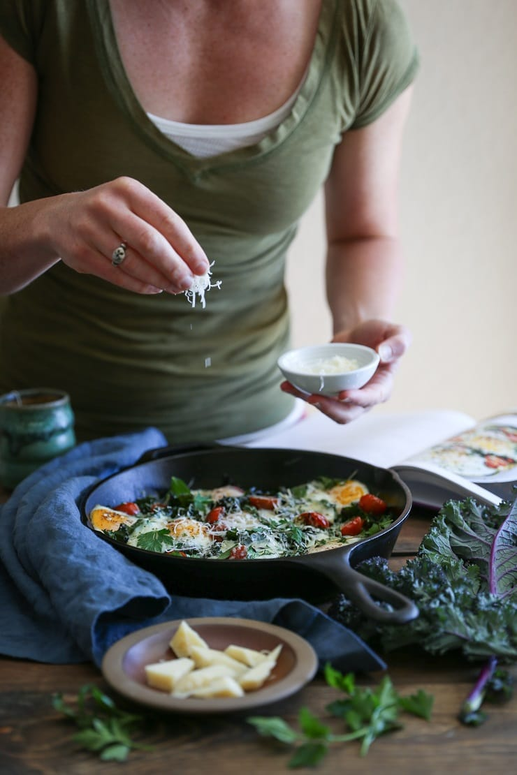 Tomato, Kale, and Parmesan Baked Eggs - a nutritious vegetarian breakfast that requires only a few ingredients.