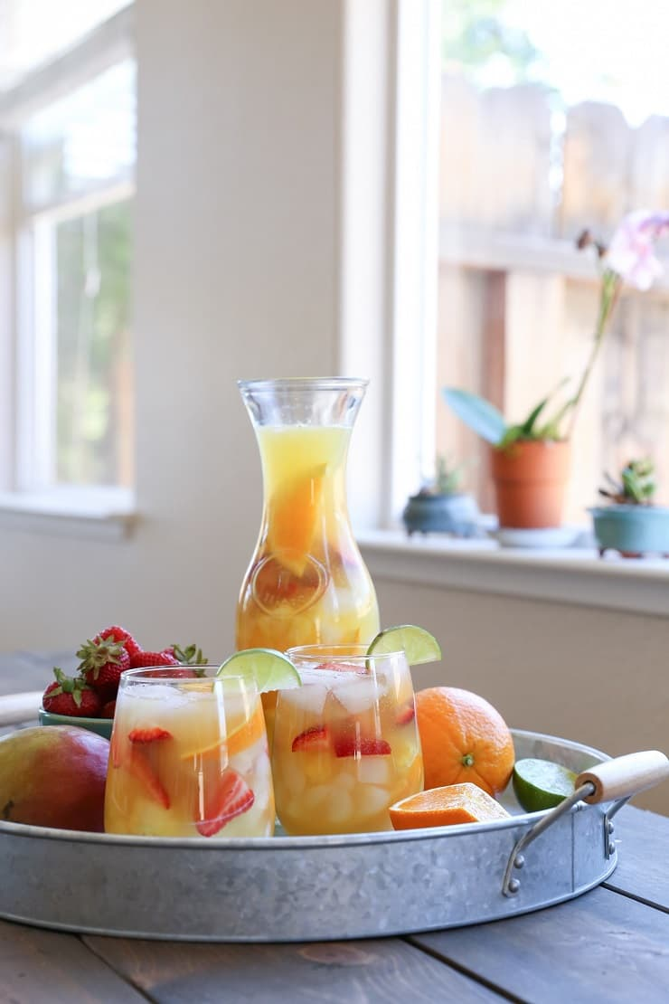 Tropical White Sangria - a naturally sweetened, cocktail recipe. So crisp, refreshing, and perfect for summer gatherings!