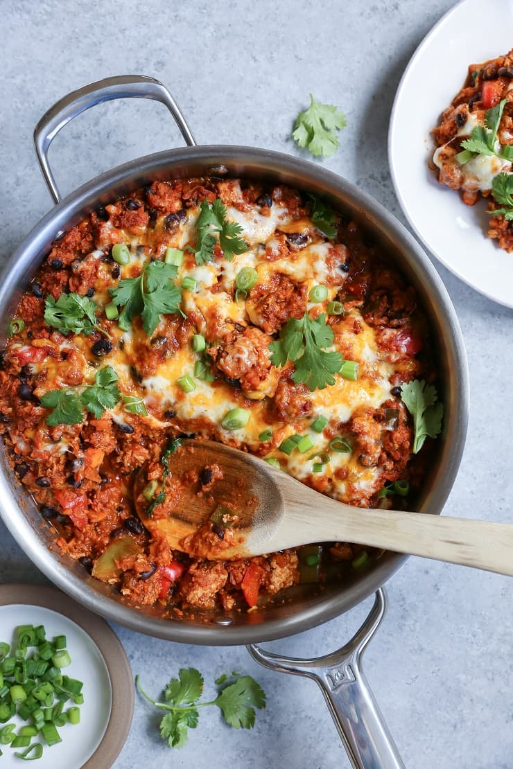 Turkey, Black Bean, and Sweet Potato Rice Enchilada Skillet - a filling meal packed with vegetables and lean protein!