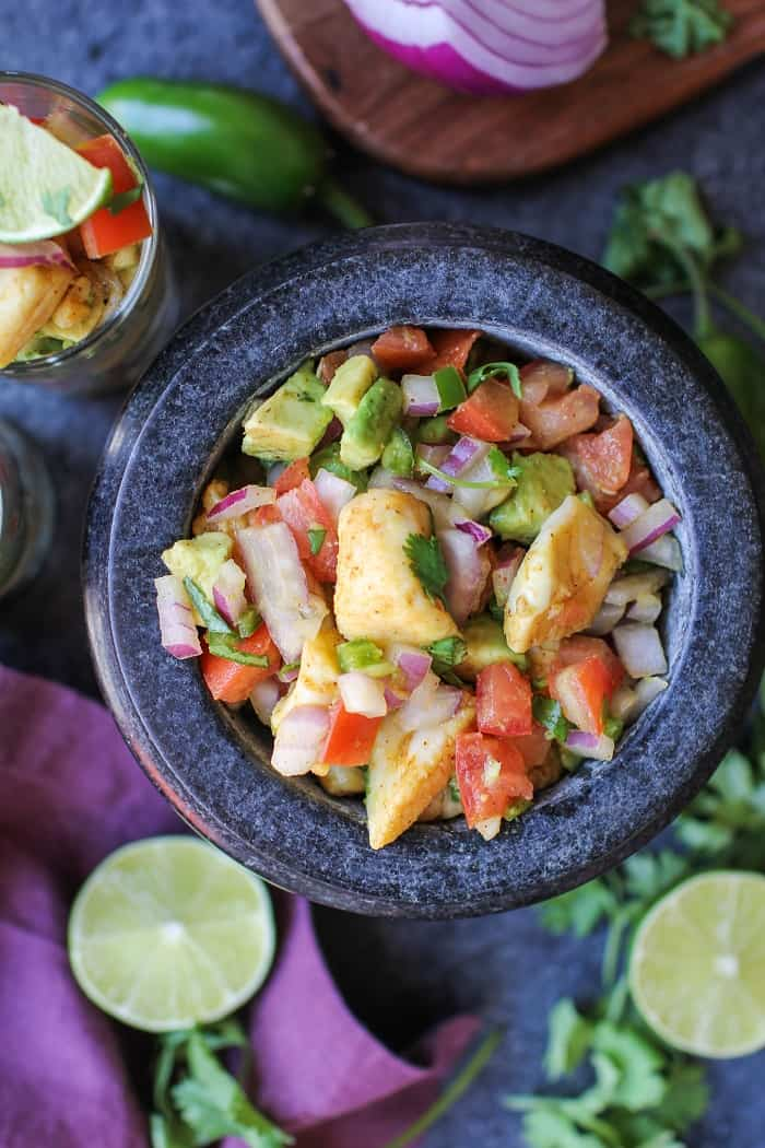 "Classic Halibut Ceviche - raw halibut ""cooked"" in lime juice and mixed with tomatoes, red onion, jalapeno, and avocado. A healthy appetizer that's gluten-free and paleo friendly!"