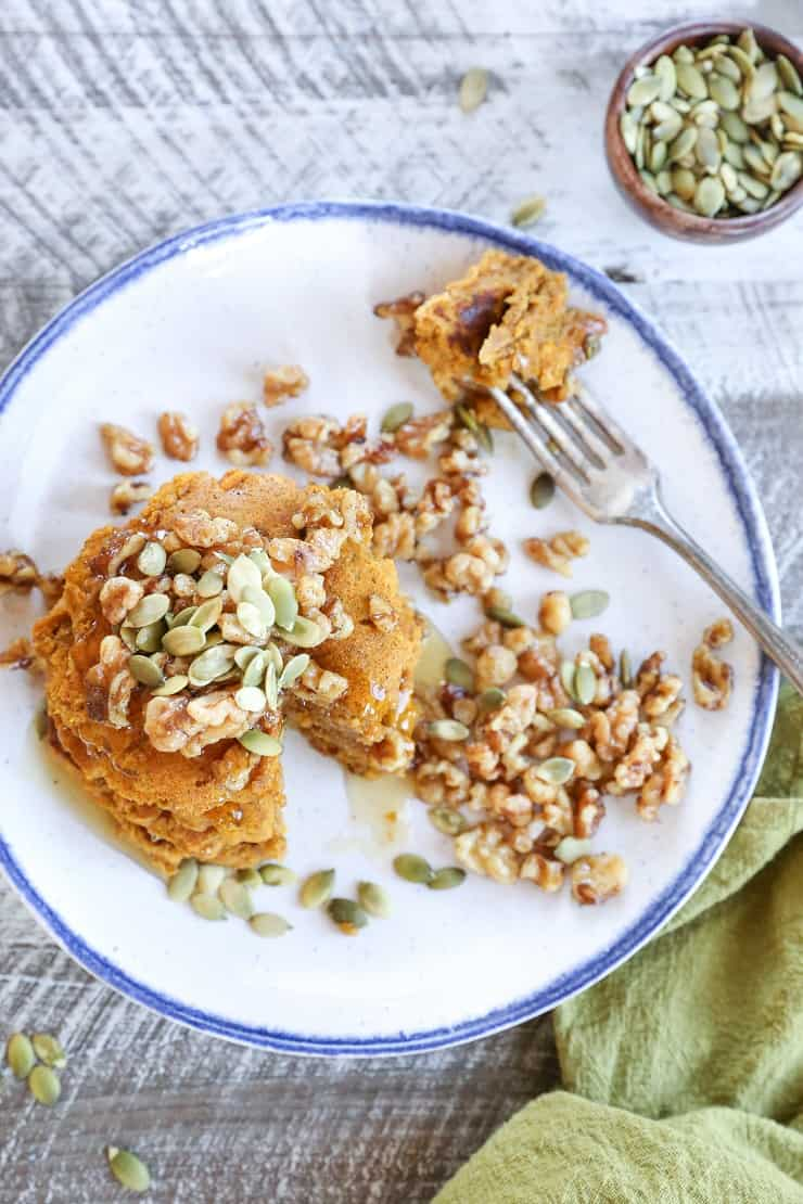 Vegan Pumpkin Pancakes with Maple-Toasted Walnuts and Pumpkin Seeds. You'd never know these pancakes are gluten-free and vegan!