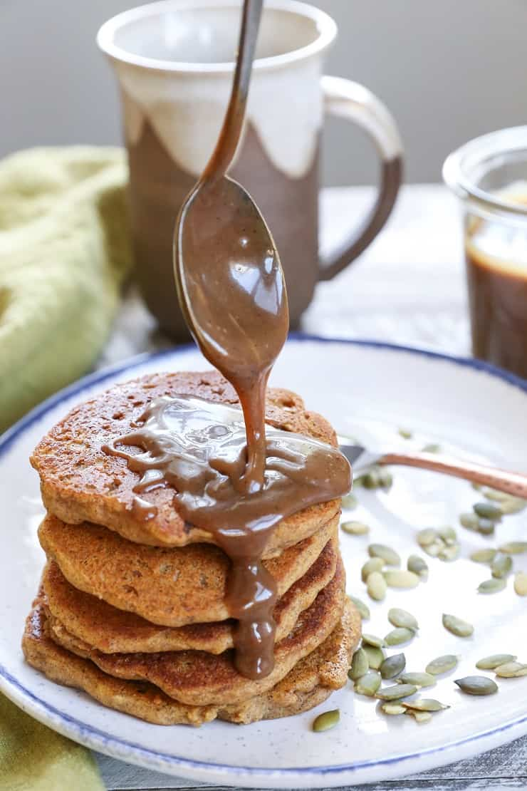Vegan Pumpkin Pancakes with Chai-Spiced Paleo Salted Caramel - moist and fluffy pancakes you'd never know are gluten-free and vegan!