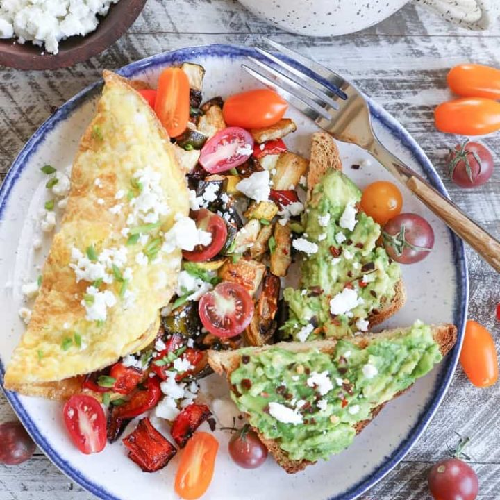 Late Summer Balsamic Roasted Vegetable Omelettes - this veggie-packed omelette includes zucchini, yellow squash, bell pepper, tomatoes, chives, and feta cheese for a winning breakfast.