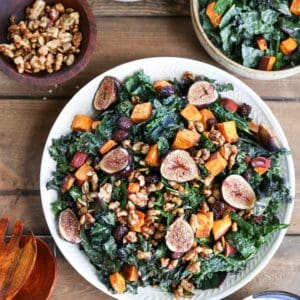 Roasted Sweet Potato and Fig Kale Salad with maple-toasted walnuts, dried cranberries, and cider vinaigrette - a healthful superfood salad that can be enjoyed as an entree or a side dish!