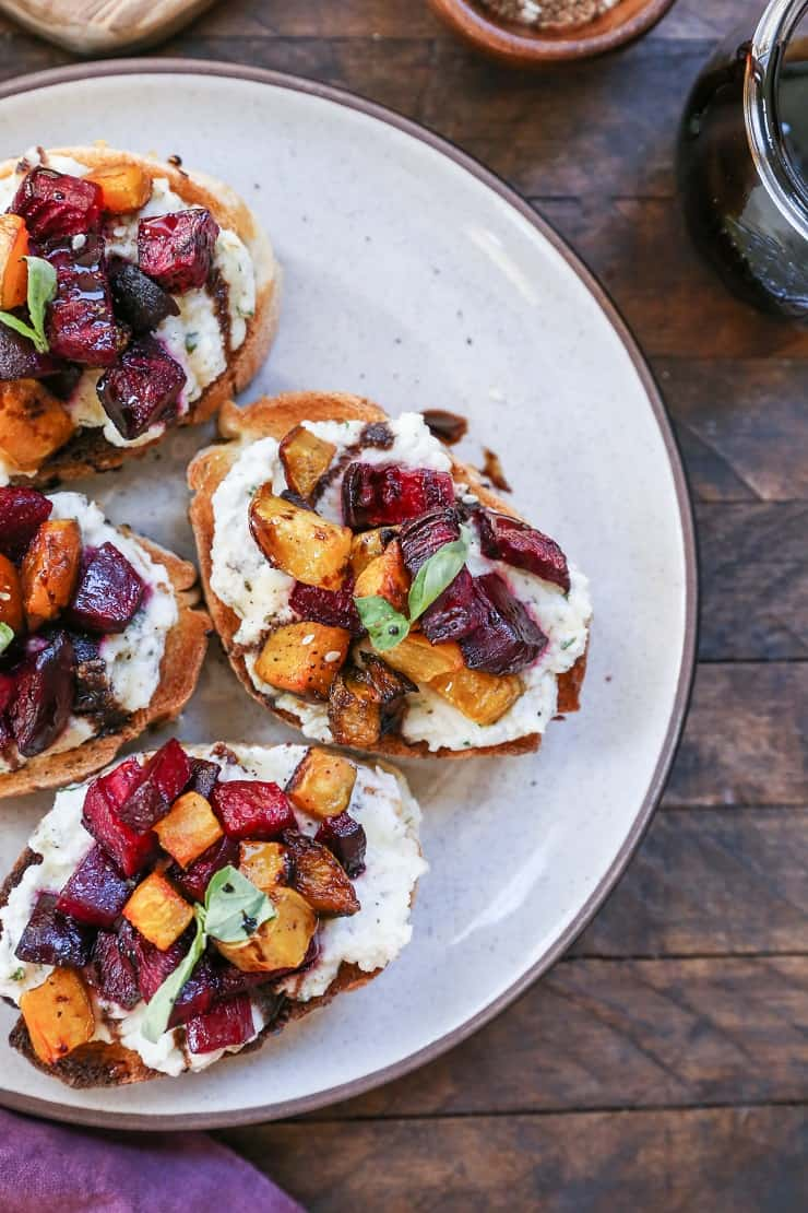 "Roasted Beet and Vegan Herbed ""Ricotta"" Crostini with balsamic and honey drizzle - a nutritious, dairy-free appetizer"