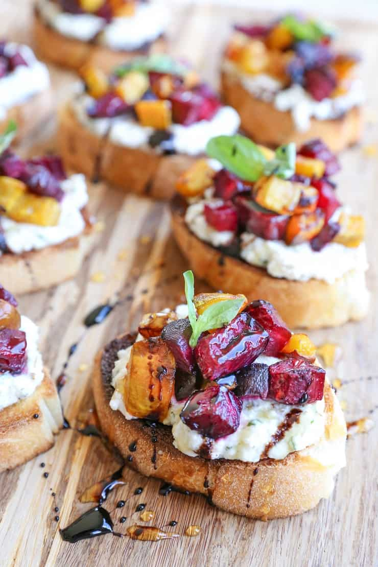 Roasted Beet Herbed Vegan Ricotta Crostini with balsamic reduction drizzle - this delicious and nutritious appetizer is plant-based and dairy-free!