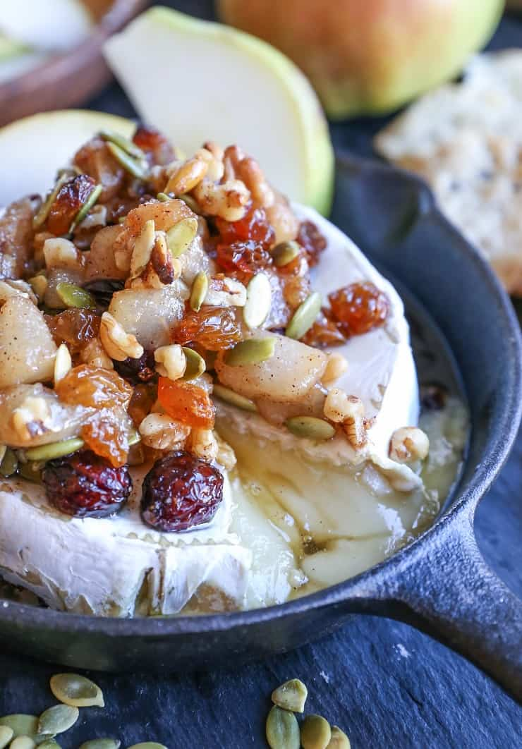 Maple-Spiced Pear Baked Brie with Walnuts, Pumpkin Seeds, and Golden Raisins - a lovely fall-inspired appetizer