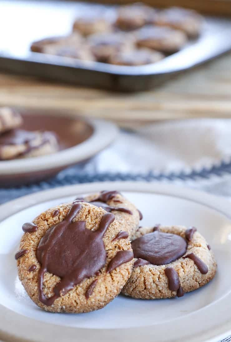 Paleo Chocolate Thumbprint Cookies - grain-free, dairy-free, naturally sweetened, made with almond flour, coconut oil, and pure maple syrup. This healthy gluten free cookie recipe is perfect for the holidays.