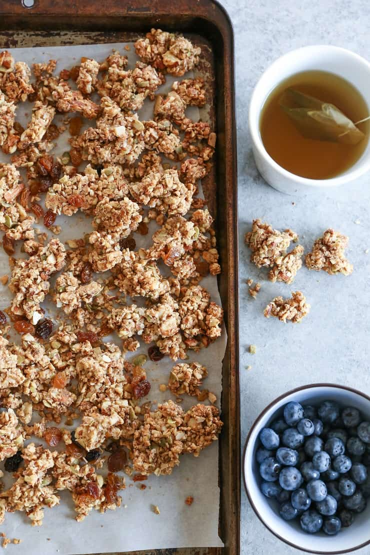 Cinnamon Raisin Paleo Granola (Vegan) - made with nuts, seeds, nut butter, and pure maple syrup for a nutritious gluten-free breakfast or snack.