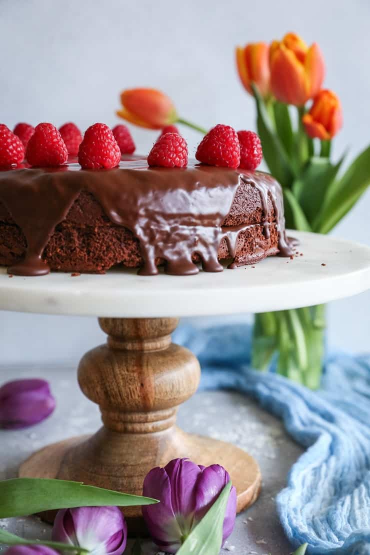 Paleo Chocolate Cake with chocolate ganache - made grain-free, refined sugar-free, and dairy-free with almond flour, coconut oil, and pure maple syrup