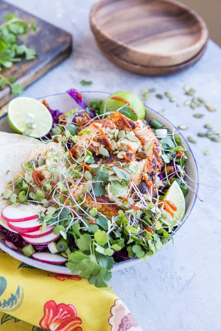 Baja Fish Taco Bowl with spicy halibut, avocado crema, and red cabbage makes for a fresh and vibrant meal