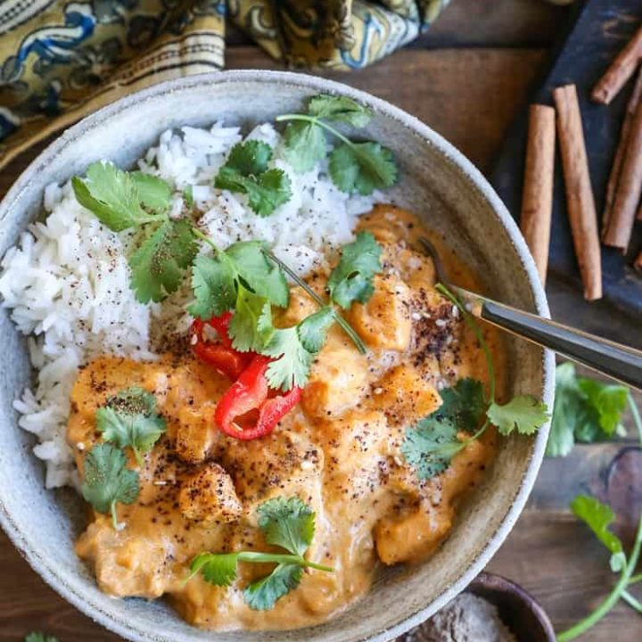 Chicken Massaman Curry - butternut squash and chicken stewed in aromatic coconut milk sauce for a satisfying meal that happens to be healthier than Thai takeout. Paleo, Whole30, and delicious