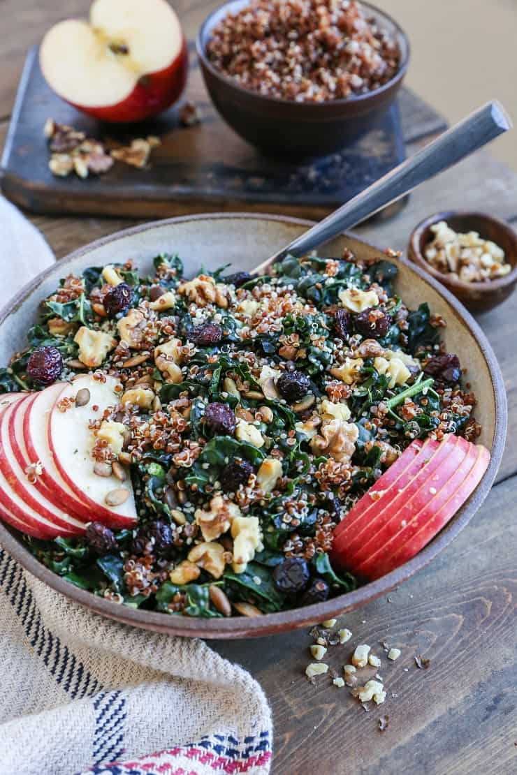Hormone-Supporting Kale and Quinoa Salad with pumpkin seeds, walnuts, apple, and dried cranberries. A superfood crunchy salad recipe.