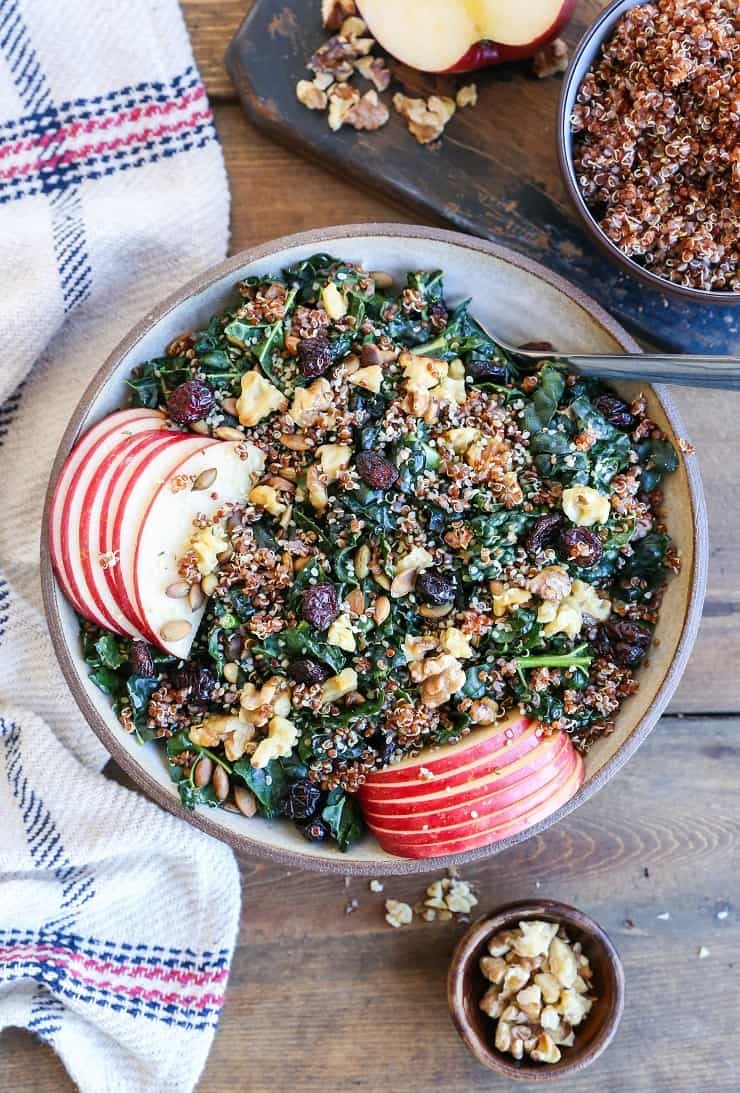 Hormone-Supporting Kale and Quinoa Salad with apple, dried cranberries, pumpkin seeds, and walnuts. A superfood crunchy salad perfect for making throughout the week
