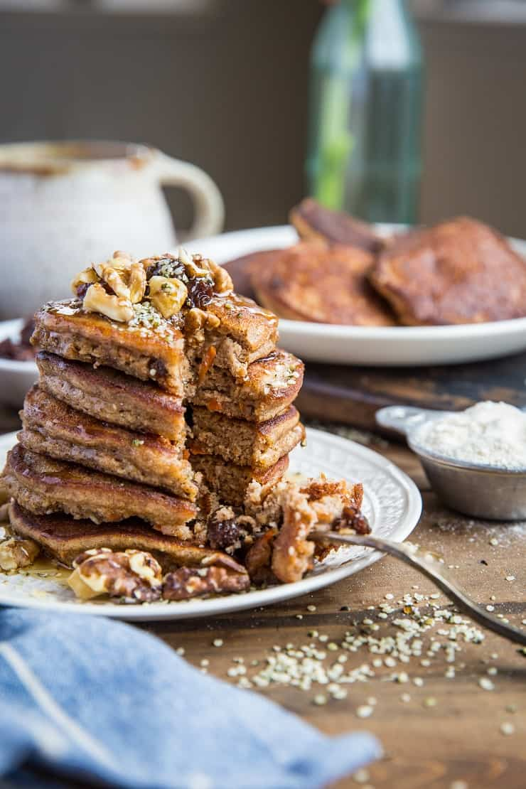 Paleo Carrot Cake Pancakes made grain-free with coconut flour. This healthy pancake recipe is refined sugar-free, dairy-free, and delcious.