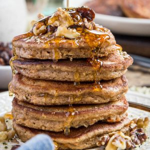 Paleo Carrot Cake Pancakes - grain-free, refined sugar-free, dairy-free, and healthy! These paleo pancakes taste like dessert for breakfast