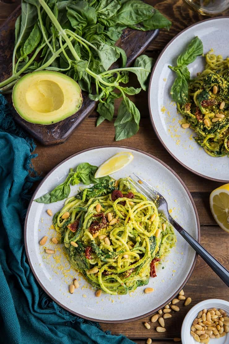 Avocado Pesto Zoodles with Spinach, Sun-Dried Tomatoes, and Pine Nuts - this simple and easy dish only takes 30 minutes to make and is vegan, paleo, and healthy