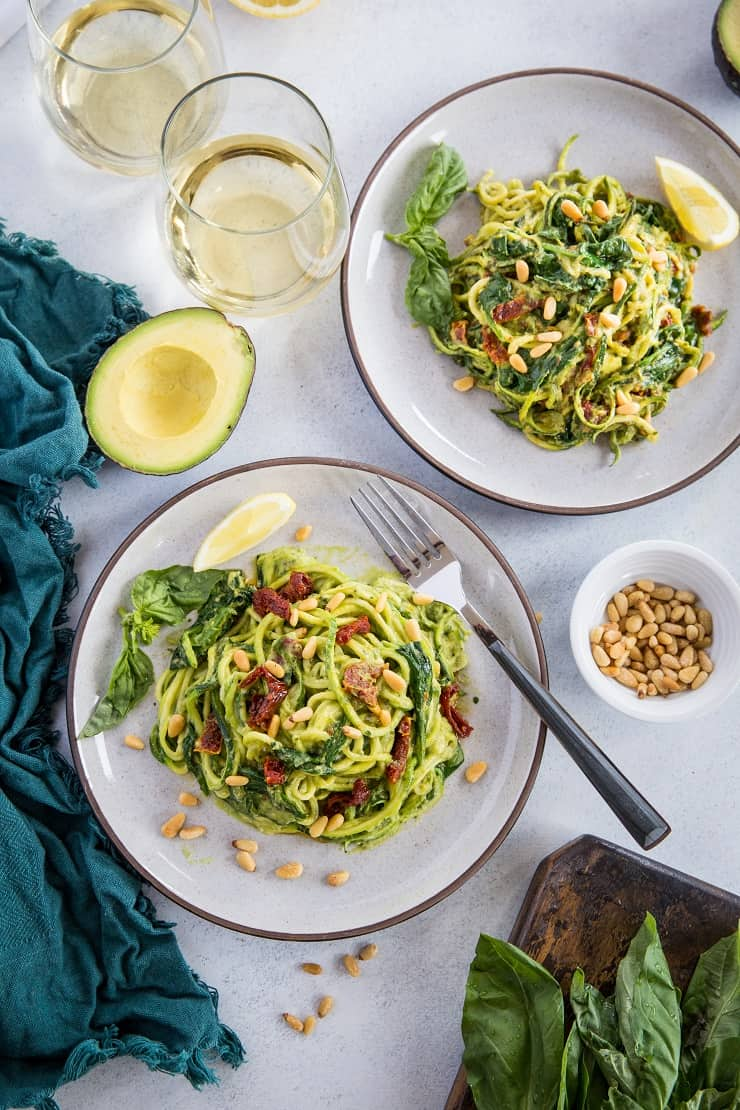 Avocado Pesto Zoodles with Sun-Dried Tomatoes, Spinach, and Pine Nuts. A healthy vegan and paleo dinner recipe that only takes 30 minutes to make