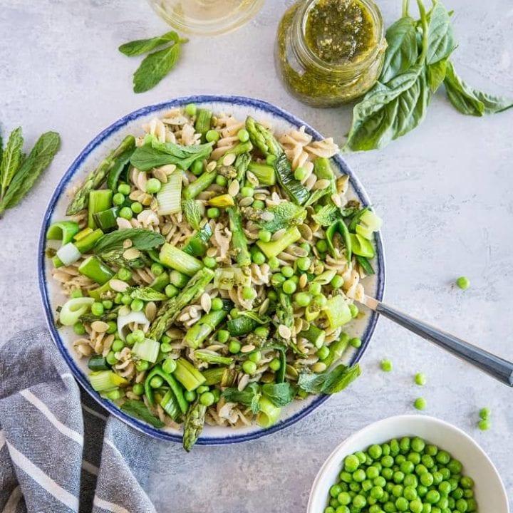 Spring Green Pasta with Vegan Basil-Mint Pesto - a healthy pasta recipe with asparagus, peas, leek, and homemade pesto sauce