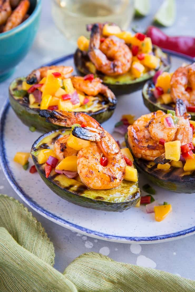 Stuffed Grilled Avocados with Grilled Shrimp and Mango Salsa - a healthy paleo appetizer perfect for BBQ season - whole30 approved and delicious