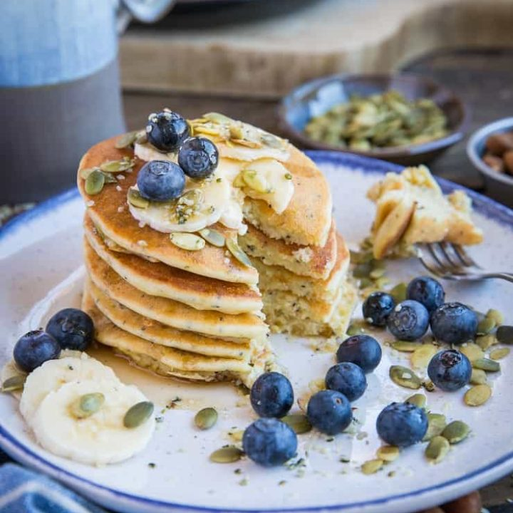 Paleo Lemon Poppy Seed Pancakes made with almond flour and almond milk. This zesty stack is healthy and delicious! Dairy-free, refined sugar-free, and grain-free