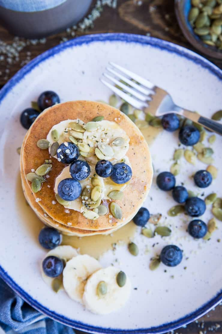 Paleo Lemon Poppy Seed Pancakes are a healthy breakfast made with almond flour and almond milk in your blender! Grain-free and dairy-free