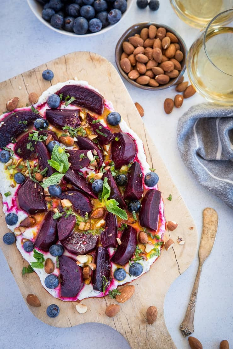 Roasted Beet Salad with Herbed Whipped Ricotta and Citrus Dressing with roasted almonds and blueberries - a perfect sharable dish for brunch