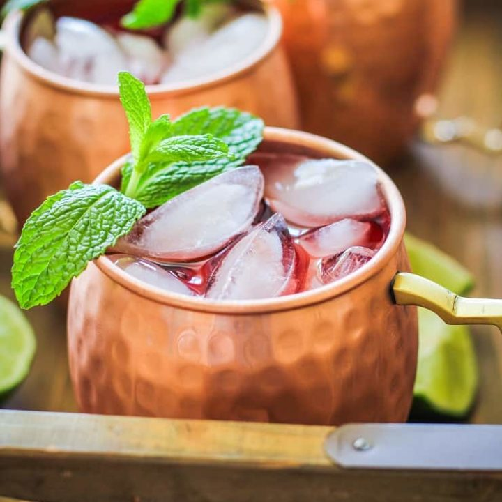 Strawberry Moscow Mules - a lower sugar Moscow Mule recipe with homemade strawberry simple syrup for a skinny cocktail