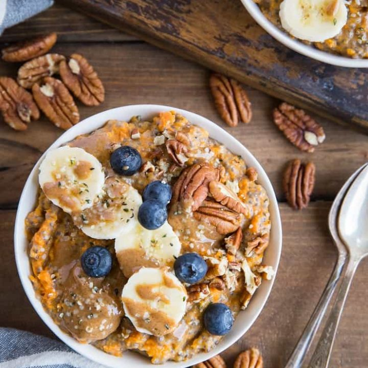 Sweet Potato Porridge with chia seeds, almond milk, pure maple syrup, banana, blueberries, pecans, and almond butter. A nutritious breakfast, snack or dessert!