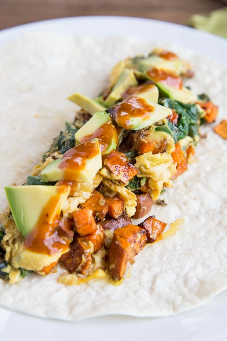 Roasted Veggie and Avocado Breakfast Burritos with sweet potato and zucchini - these healthy breakfast burritos are packed with nutrients.