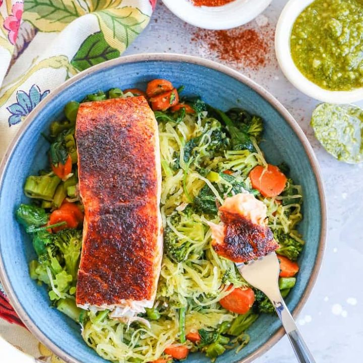 Crispy Salmon Bowls with Pesto Spaghetti Squash and Roasted Vegetables - these nutritious bowls are keto, paleo, low-carb, and whole30   TheRoastedRoot.com @TheRoastedRoot #glutenfree