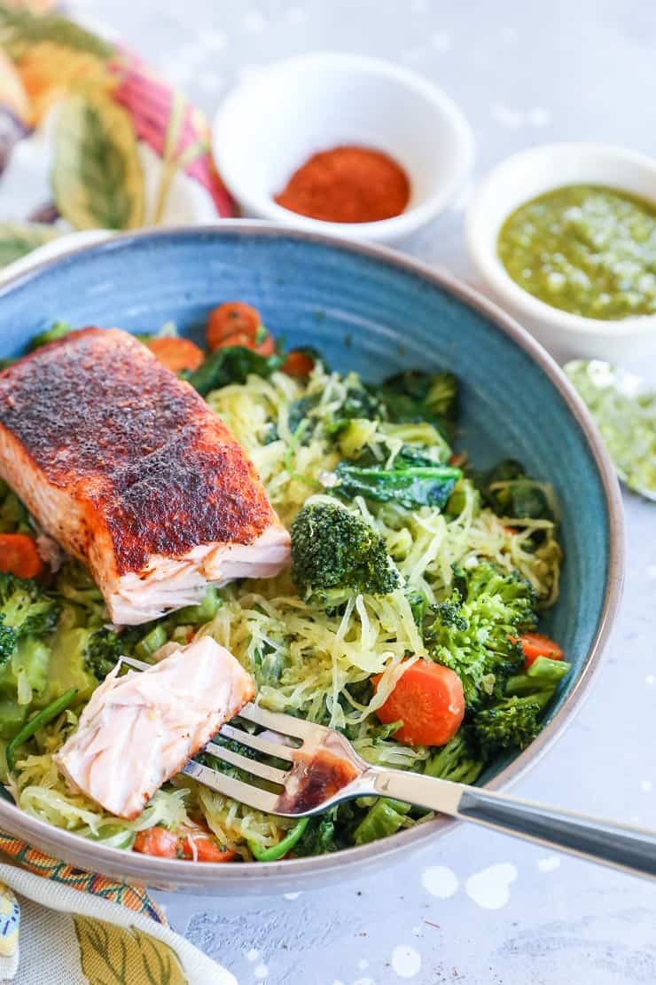 Crispy Salmon Bowls with Pesto Spaghetti Squash and Sauteed Vegetables - these nutritious bowls are keto, paleo, low-carb, and whole30 | TheRoastedRoot.com @TheRoastedRoot #glutenfree