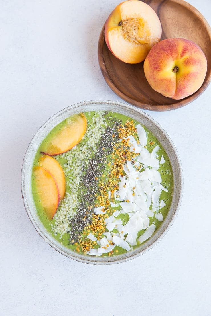 Ginger Peach Smoothie Bowl made banana-less using steamed and frozen cauliflower, orange juice, and almond milk. A healthy, vibrant breakfast