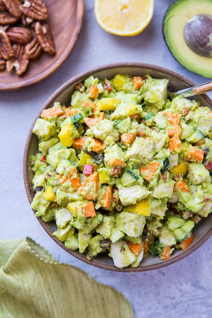 Mayo-Free Mango Avocado Chicken Salad - a healthier chicken salad recipe with carrots, cucumber, green onion, bell pepper, raisins, and pecans. Serve it up on toasted bread as a sandwich or on a green salad!