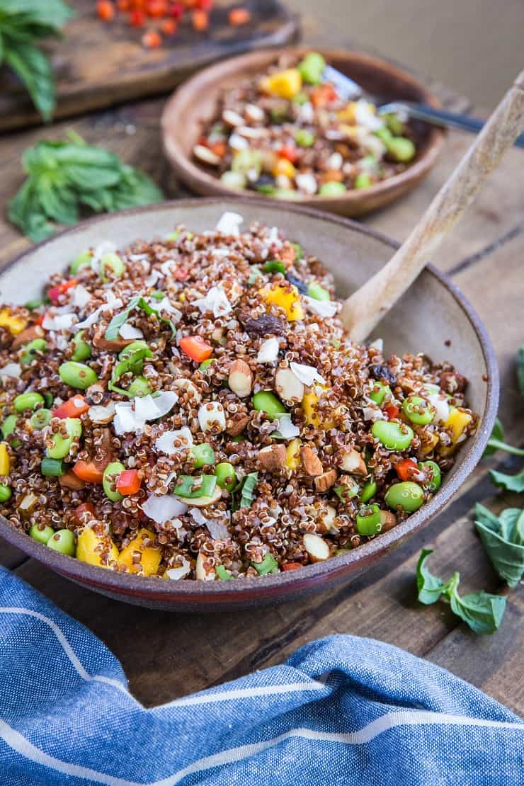 Mango Edamame Quinoa Salad with roasted almonds, flaked coconut, bell pepper, and basil. A highly nutritious salad perfect for picnics and barbecues
