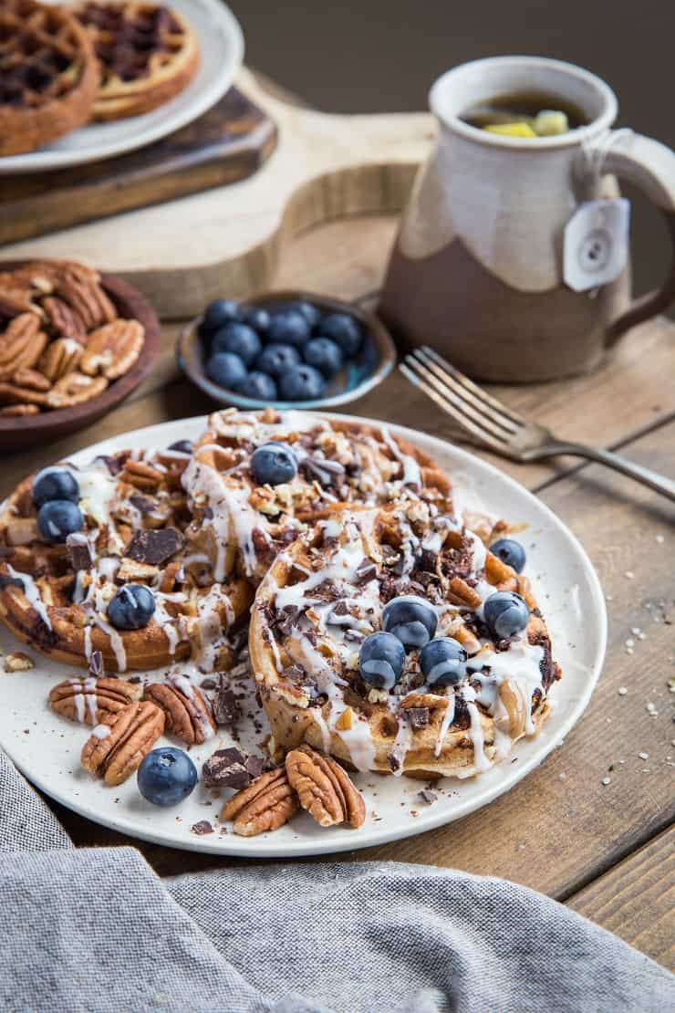 Paleo Chocolate Pecan Waffles with almond butter, coconut butter, and blueberries. This grain-free waffle recipe is prepared in your blender and tastes magnificent!