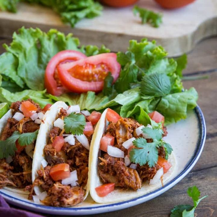 Carnitas and Chorizo Tacos - slow cooked shredded pork and chorizo make an amazingly flavorful taco! Set it up in the morning and have it ready by the time you get home from work! | TheRoastedRoot.net #glutenfree