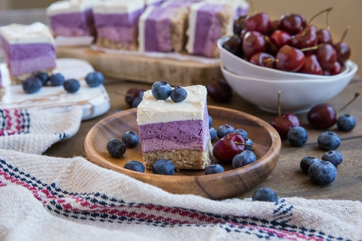 Cherry Blueberry Vegan Layered Cheesecake Bars - gorgeous cheesecake made with soaked cashews and pure maple syrup for a dairy-free take on cheesecake. | TheRoastedRoot.com