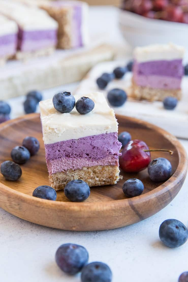 Dairy-Free Cherry Blueberry Vegan Layered Cheesecake Bars - gorgeous cheesecake made with soaked cashews and pure maple syrup for a dairy-free take on cheesecake. | TheRoastedRoot.com