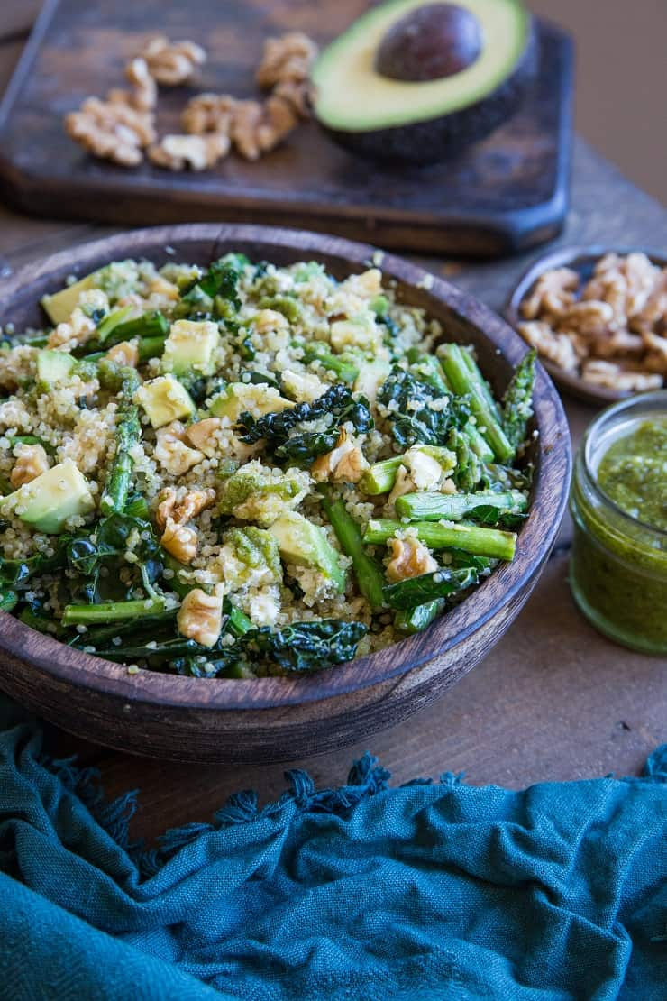 Pesto Quinoa Salad with Kale, Asparagus, Avocado, Walnuts, and Feta. A light and refreshing side dish perfect for sharing