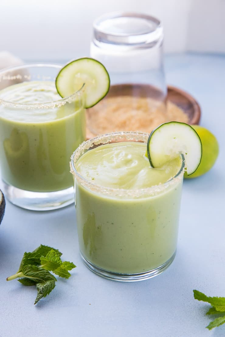 Tropical Avocado Cocktail with mango, pineapple juice, coconut milk, cucumber, mint and lime. These healthy refined sugar-free cocktails are refreshing and delicious!
