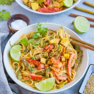 This plant-based vegan red curry zucchini noodle bowl is fresh, frisky, and comforting while keeping it low-carb. I'll be the first to admit I don't reinvent the wheel when it comes to curry. I make curry nearly weekly, and while I can 200% go the authentic route by grinding my own spice blend, I am not at all above using a store-bought curry paste. It just makes dinner easy in a pinch!